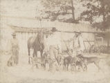 """Warden Jackson and his pack after the capture of a fugitive - Sprague Junction, Alabama."""