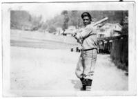 Baseball Player Holding a Bat, circa 1942