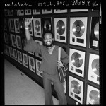 Maurice White of Earth, Wind and Fire before wall of gold records, Calif., 1976