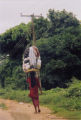 Young woman carrying a bundle