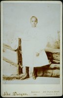 African-American girl in high button shoes, probably a relative of the Carrington family of Norwich, in New York