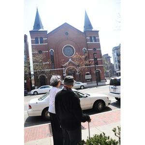 Reverend Chauncy Moore and Lolita Parker, Jr. walking on Columbus Avenue.