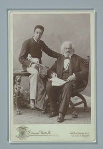 Cabinet card of Frederick Douglass with his grandson, Joseph Douglass