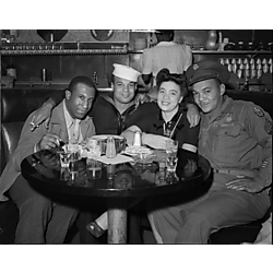 Officer, sailor, and civilian man and woman at booth in Crawford Grill?