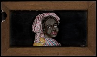 "Magic lantern slide-painting of ""Topsy:"" black woman with colorful dress and headdress; eyes roll in sockets when under-glass is shifted"