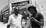 Augie's Distinctive Cleaners owners posing in front of their business. Los Angeles, 1983