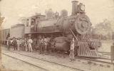 Group standing in front of a train, probably part of the Southern Railway.
