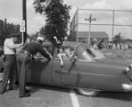 Students in a car protesting the integration of Phillips High School in Birmingham, Alabama.