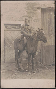[Unidentified African American soldier in uniform with handgun in holster riding a horse]