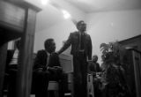 Thumbnail for Richard Boone standing behind a podium after speaking to an audience at First Baptist Church in Eutaw, Alabama.