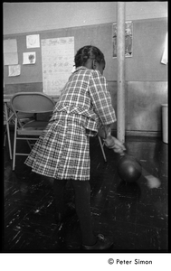 Young girl playing in the classroom at the Liberation School