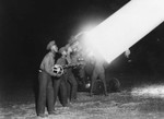 Men operating searchlight