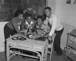 African American teenagers hosting a show at radio station WRMA in Montgomery, Alabama.