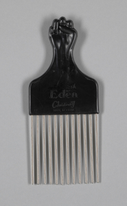 Afro hair comb with black fist design