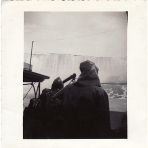 Reverend Dr. Wm. Frederick Fisher observes at the Niagara Falls.