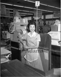 Cashier at grocery store register, Los Angeles, ca. 1958