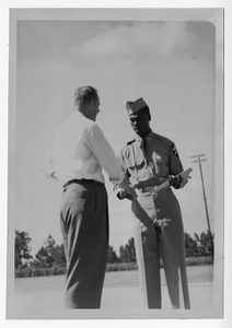 Photograph of city commissioner James Johnson and Sergeant Albert Dixon, Manchester, Georgia, 1953