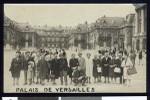 Group of travelers pose at Palace of Versailles, 1950, Paris