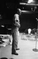 Etheridge Knight: Oxford, Miss. Knight performing at microphone in front of small audience (EKP 2-79-12/11 #295)