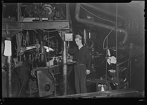 Millville, New Jersey - Glass bottles. Whitall Tatum Co. A worker running a Lynch bottle machine. This is an older machine than the I. S.