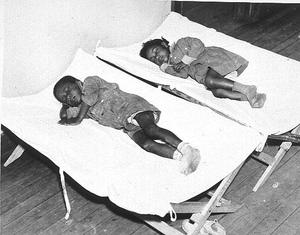 DeKalb County Nursery. African American children sleeping on cots