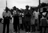 Dan Houser, Lula Williams, Richard Boone, and others, standing at the corner of Day Street and Greyhound Street in Montgomery, Alabama, during a civil rights demonstration.