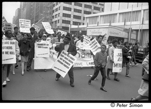 Harlem Peace March: Progressive Labor Party march behind banner reading 'Get out of Vietnam now': African American antiwar protesters marching through the New York streets, signs reading 'Black men should fight white racism, not Vietnamese freedom fighters