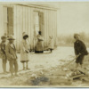 Black boy splitting wood at a schoolhouse in Tennessee
