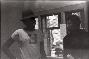 Two unidentified African American men (one in UMass Amherst t-shirt) in the UMass Student Union