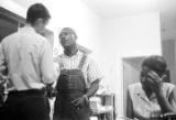 Roosevelt Barnett speaking to a man in an office, possibly the headquarters of the SCLC in Montgomery, Alabama.