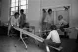 Children play on seesaws.