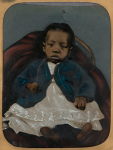 Infant on Red Chair
