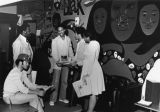 African-American students gather around a mural, circa 1970