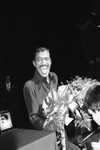 Sammy Davis Jr. laughing with a bouquet of flowers, Los Angeles, 1980