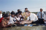 Albert Brewer signing autographs during a campaign rally in Walker County, Alabama.