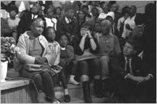Audience probably listening to Martin Luther King, Jr., speak at a church building in Greenville, Alabama.