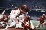 Alabama player, probably Major Ogilvie (#42), scoring a touchdown during the 1980 Sugar Bowl game at the Superdome in New Orleans, Louisiana.