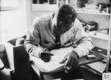 Man Smoking and Writing