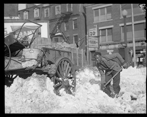 Colored man digging out horse and cart