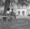 Susie Sanders and Shirley Martin seated on a bench on the lawn of Sidney Lanier High School in Montgomery, Alabama.