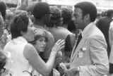 """Andrew Young speaking to a woman in a crowd in downtown Atlanta, Georgia, during the Democratic National Committee's regional conference, """"Victory '68."""""""