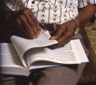 Dewey Williams, one of the Wiregrass Sacred Harp Singers, holding a hymnbook.