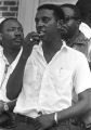 """Stokely Carmichael addressing a crowd in front of the Neshoba County Library in Philadelphia, Mississippi, during the """"March Against Fear"""" begun by James Meredith."""