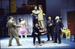 """Actors (L-R) Brian Murray, Anne Bobby, Raymond Xifo, Peter MacNicol and Kate Mulgrew (on table), Robert Stattel and Keene Curtis in a scene from the Roundabout Theater Co.'s production of the play """"Black Comedy """" (New York)"""