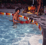 G. C. Cameron and Gwen Gordy Fuqua in the pool during a party, Los Angeles