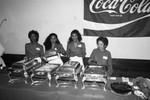 Coca-Cola sponsored event participants serving food, Los Angeles, 1984
