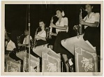"[Four women in the saxophone section of the ""Sweethearts"" performing, undated.] [black-and-white photoprint]"