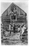 [Men preparing to lynch African American man by hanging]