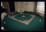 Baseball diamond diorama with figures carved from peach seeds