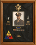 Framed collection of officer's insignia